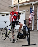 Capt. Hunter Barnhill, 37th Flying Training Squadron instructor pilot, stands with his training equipment May 15, 2018, on Columbus Air Force Base, Mississippi. Barnhill qualified for the Air Force Wounded Warrior team in the shooting, cycling and indoor rowing events. He will be competing in all three events at the 2018 Warrior Games June 1-9 at the U.S. Air Force Academy in Colorado Springs, Colorado. (U.S. Air Force photo by Airman 1st Class Keith Holcomb)