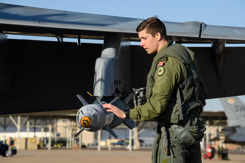 Royal Canadian Air Force pilot Capt. Hamilton, 433rd Tactical Fighter Squadron, performs pre-flight inspections May 3, 2018, at Hill Air Force Base, Utah. The Canadian unit participated in a Weapons System Evaluation Program, or WSEP, exercise conducted by the 86th Fighter Weapons Squadron, a Hill tenant unit. (U.S. Air Force photo by R. Nial Bradshaw)
