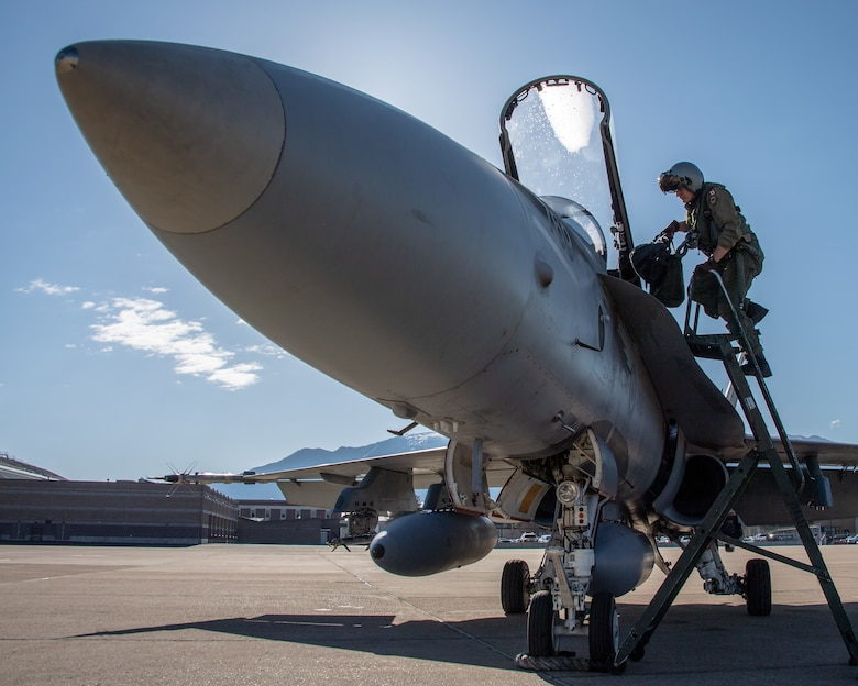 Royal Canadian Air Force pilot Capt. Jason Berndt, assigned to the 433rd Tactical Fighter Squadron, climbs a ladder to the cockpit of an F-18A fighter jet May 3, 2018, at Hill Air Force Base, Utah. The Canadian unit participated in a Weapons Evaluation Systems Program, or WSEP, exercise conducted by the 86th Fighter Weapons Squadron, a Hill tenant unit. (U.S. Air Force photo by R. Nial Bradshaw)