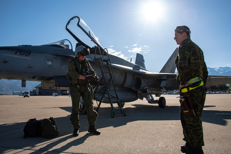 Royal Canadian Air Force pilot Capt. Jason Berndt and structural technician Cpl. Matthew Roy, assigned to the 433rd Tactical Fighter Squadron, perform pre-flight checks May 3, 2018, at Hill Air Force Base, Utah. The Canadian unit participated in a Weapons Evaluation Systems Program, or WSEP, exercise conducted by the 86th Fighter Weapons Squadron, a Hill tenant unit. (U.S. Air Force photo by R. Nial Bradshaw)