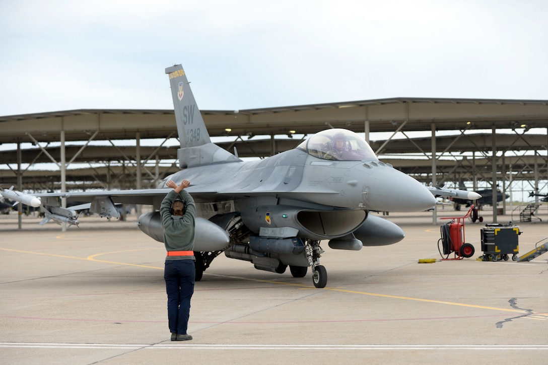 Airman 1st Class Krystin Bartelt, 79th Fighter Squadron, provides recovery support for an F-16 from Shaw Air Force Base, South Carolina, after a training mission, May 10, 2018, at Hill Air Force Base, Utah. The unit participated in a Weapons System Evaluation Program, or WSEP, exercise conducted by the 86th Fighter Weapons Squadron, a Hill tenant unit. (U.S. Air Force photo by Todd Cromar)