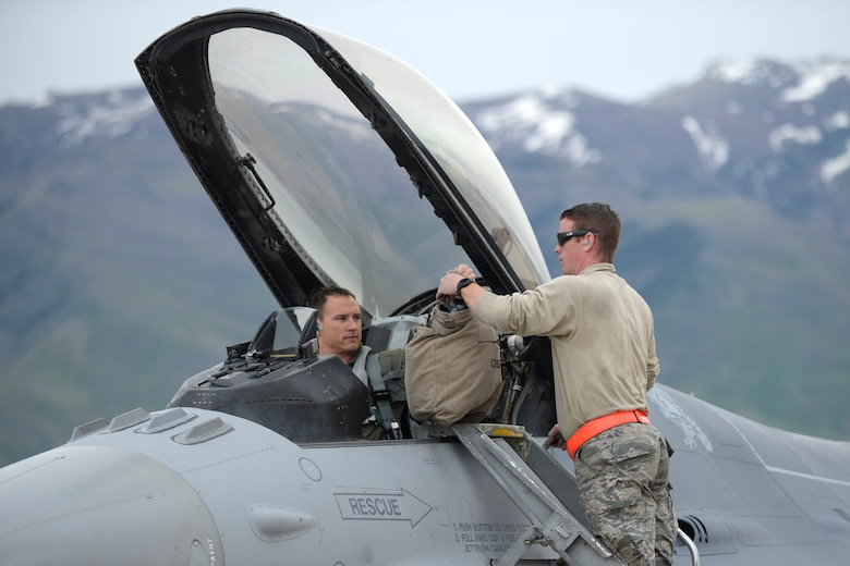 "Staff Sgt. Jeremy Andrews, 79th Fighter Squadron, provides recovery support to Major Brian Lewis, ""Chewy"", after returning from an F-16 training mission, May 10, 2018, at Hill Air Force Base, Utah. The unit from Shaw Air Force Base, South Carolina, participated in a Weapons System Evaluation Program, or WSEP, exercise conducted by the 86th Fighter Weapons Squadron, a Hill tenant unit. (U.S. Air Force photo by Todd Cromar)"