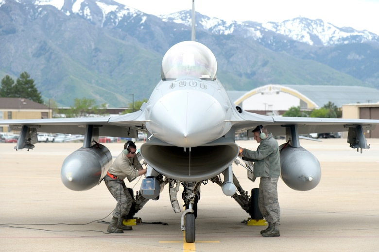 Staff Sgt. Jeremy Andrews and Staff Sgt. Brian Staller, both with 79th Tactical Fighter Squadron, provide recovery support for an F-16 from Shaw Air Force Base, South Carolina, after a training mission, May 10, 2018, at Hill Air Force Base, Utah. The unit participated in a Weapons System Evaluation Program, or WSEP, exercise conducted by the 86th Fighter Weapons Squadron, a Hill tenant unit. (U.S. Air Force photo by Todd Cromar)
