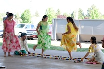 Filipino dancers perform the Tinikling, a traditional cultural dance, at the American Asian Pacific Islander Festival, May 17, 2018, at Hill Air Force Base, Utah. The annual AAPI Festival, held at Centennial Park allowed visitors to experience and enjoy traditional foods, while celebrating the rich, diverse cultures of Asia and the Islands with dances and entertainment. (U.S. Air Force photo by Todd Cromar)