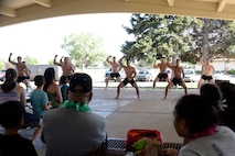 Active duty Airmen preform a traditional Polynesian Haka War Cry at the American Asian Pacific Islander Festival, May 17, 2018, at Hill Air Force Base, Utah. The annual AAPI Festival, held at Centennial Park allowed visitors to experience and enjoy traditional foods, while celebrating the rich, diverse cultures of Asia and the Islands with dances and entertainment. (U.S. Air Force photo by Todd Cromar)