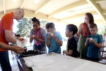 Volunteers from the crowd participate in a Balut eating contest, a Filipino delicacy, at the American Asian Pacific Islander Month Festival, May 17, 2018, at Hill Air Force Base, Utah. The annual AAPI Festival, held at Centennial Park, allowed visitors to experience and enjoy traditional foods, while celebrating the rich, diverse cultures of Asia and the Islands with dances entertainment. (U.S. Air Force photo by Todd Cromar)