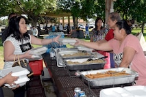 Members of the Utah Filipino Association serve traditional Filipino dishes at the American Asian Pacific Islander Festival, May 17, 2018, at Hill Air Force Base, Utah. The annual AAPI Festival, held at Centennial Park allowed visitors to experience and enjoy traditional foods, while celebrating the rich, diverse cultures of Asia and the Islands with dances and entertainment. (U.S. Air Force photo by Todd Cromar)