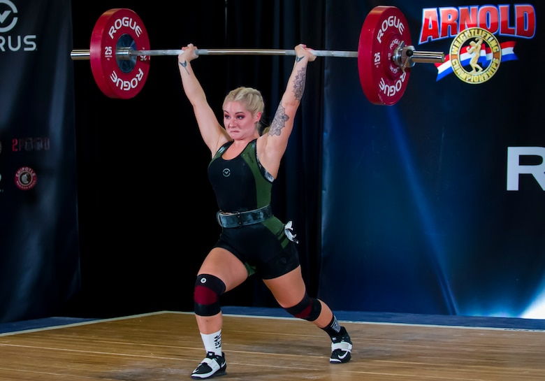 Staff Sgt. Bailey Jewell, a compliance assessor with the National Air and Space Intelligence Center Inspector General's office, participates in an Olympic Weightlifting competition during the Arnold Sports Festival March 1, 2018 at the Greater Columbus Convention Center in Columbus, Ohio. Jewell reached a new personal meet record, lifting more than 282 pounds. (U.S. Air Force photo/Senior Airman Jonathan Stefanko)