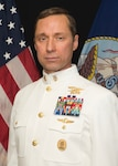 Official portrait of retired Navy Master Chief Petty Officer Britt K. Slabinski in dress-white uniform.