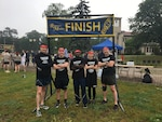 From left: Air Force Maj. Brian Jorgensen, Navy Lt. Brent Cohen, Air Force Master Sgt. Thomas Baah, Army Maj. Tracy Yates and Marine Lt. Col. Ian Galbraith relax after completing the event. Courtesy photo