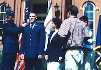Col. Richard Evans, West Virginia University aerospace science professor and Detachment 915 commander, pins a gold bar on 2nd Lt. Jason Camilletti, WVU ROTC graduate, during his promotion ceremony May 15, 1999.
