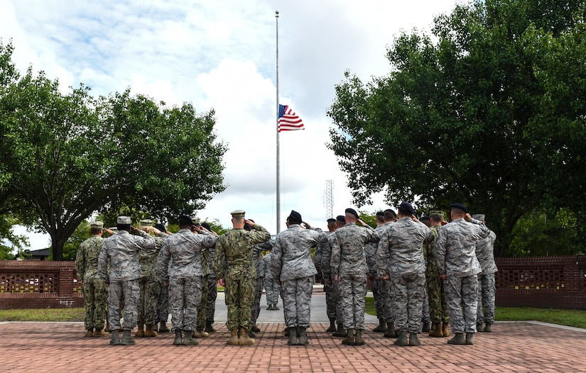 Service members stand in formation during a retreat ceremony May 18, 2018, at Joint Base Charleston, S.C.