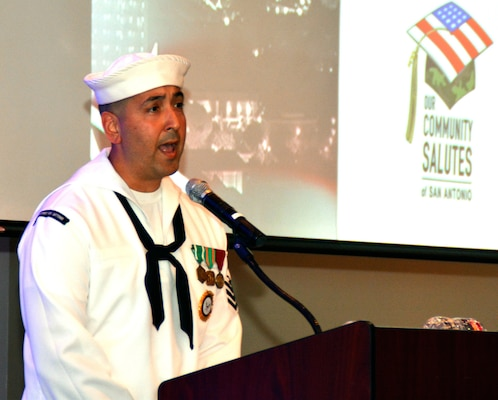 "Petty Officer 1st Class Steven Comacho of Stockton, Calif., assigned to Navy Recruiting District San Antonio, sings the national anthem during ""A Night in Your Honor"" hosted by Our Community Salutes-San Antonio (OCS) held in the Rosenberg Sky Room at the University of the Incarnate Word May 16."