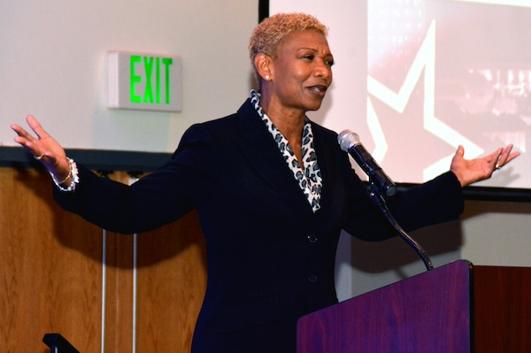 "Retired Navy Fleet Master Chief April Beldo speaks to future service members, their families, educators, business leaders and military members during ""A Night in Your Honor"" hosted by Our Community Salutes-San Antonio held in the Rosenberg Sky Room at the University of the Incarnate Word May 16.  Beldo was the first African-American female command master chief of an aircraft carrier and Navy Recruit Training Command."