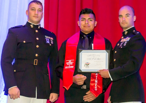 "Marine Maj. Christopher Richardella, Recruiting Station San Antonio commanding officer, and Capt. Mike Pagani pose with a future Marine, who was honored during ""A Night in Your Honor"" hosted by Our Community Salutes-San Antonio held in the Rosenberg Sky Room at the University of the Incarnate Word May 16."