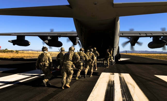 Rescue personnel transload onto an HC-130J Combat King II during a mission as part of Red Flag-Rescue 18-2 near Davis-Monthan Air Force Base, Ariz., on May 8, 2018. Red Flag-Rescue gives joint service personnel an opportunity to build fundamental combat search and rescue skills to fight in and out of contested environments. (U.S. Air Force Photo by Staff Sgt. Trevor T. McBride)