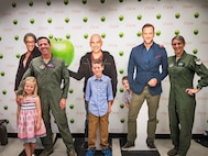 Lt. Col. Maura George, Maj. Derik George and their children pose with The Chew host cutouts prior to joining the hosts on camera as program special guests. (U.S. Air Force photo by Tech. Sgt. Andy Davis, SAF/PAON, NYC)