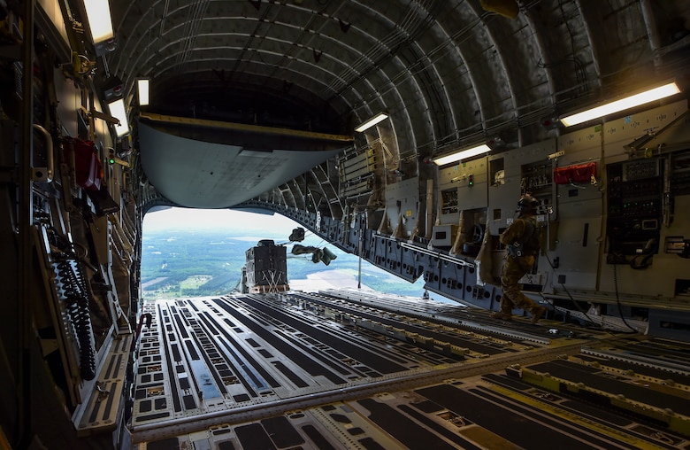 Cargo is dropped from a C-17 Globemaster III during the large formation exercise at Joint Base Charleston, S.C., May 22, 2018.