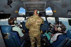 Col. Jimmy Canlas, Airlift Wing commander, talks to civic leaders in the cockpit of a C-17 Globemaster III during the large formation exercise at Joint Base Charleston, S.C., May 22, 2018.