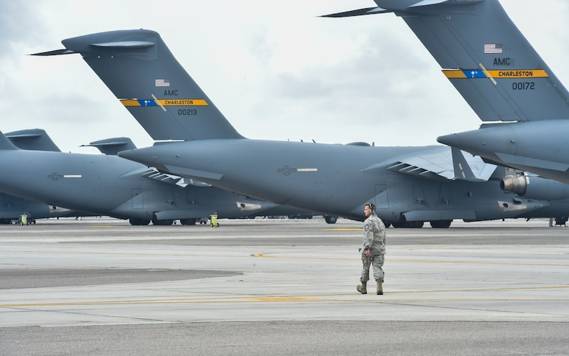 A crew chief walks the flightline before takeoff of the large formation exercise at Joint Base Charleston, S.C., May 22, 2018.