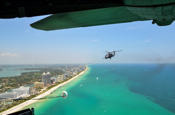 Citizen Airmen from the 920th Rescue Wing fly an HH-60G Pave Hawk helicopter over Miami Beach during the National Salute to America's Heroes Air and Sea Show media day, May 26, 2017. Top tier U.S. military assets have assembled in Miami to showcase air superiority while honoring those who have made the ultimate sacrifice during the Memorial Day weekend. The 920th Rescue Wing, the Air Force Reserve's only rescue wing, will headline the air show by demonstrating combat-search-and-rescue capabilities by teaming up with a HC-130P/N Combat King and four A-10 Thunderbolt II aircraft. (Photo by Senior Airman Brandon Kalloo Sanes)
