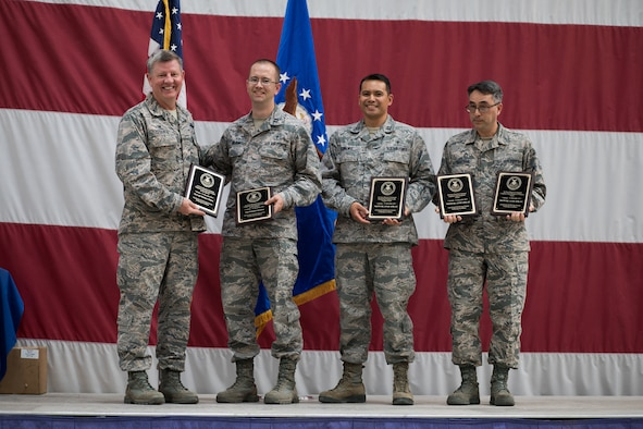 Col. Bryan Cook (left), 944th Fighter Wing commander, presents the 2017 Air Force Reserve Command Chaplain Corps Awards to the 944 FW Chaplain team during a commander's call, May 5.