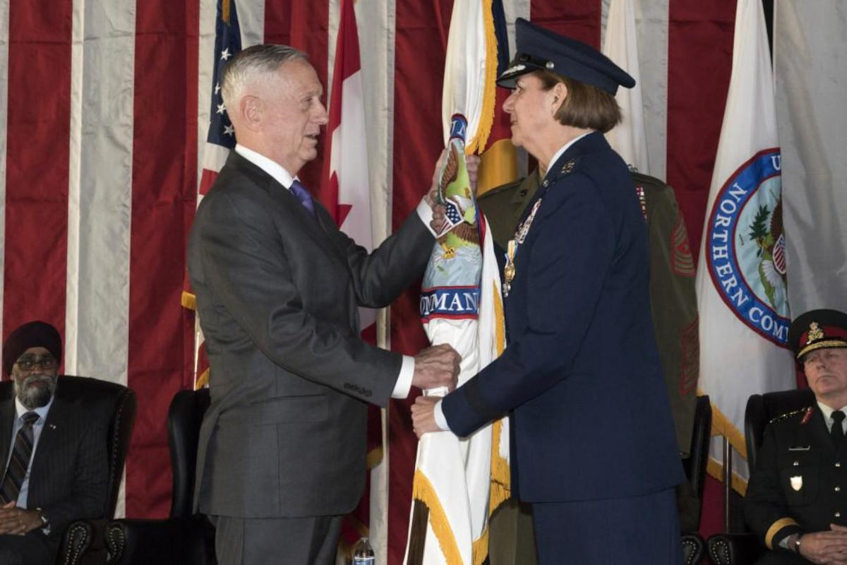 Defense Secretary James N. Mattis receives U.S. Northern Command's flag from Air Force Gen. Lori J. Robinson.