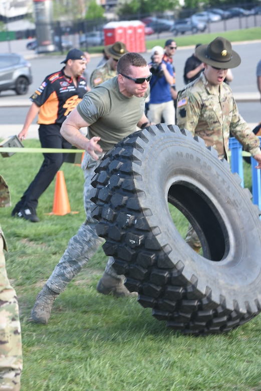 A five-man team from the 193rd Special Operations Security Forces Squadron competes in the inaugural Military and Pit Crew Challenge, in Philadelphia, Pennsylvania, Tuesday, May 8, 2018. The challenge was one of the third annual NASCAR XFINITY Philadelphia Takeover events brought to Philadelphia by Pocono Raceway, Dover International Speedway and Comcast to celebrate the sport in advance of upcoming races near at Pocono and Dover. (U.S. Air Force Photo by Master Sgt. Culeen Shaffer/Released)
