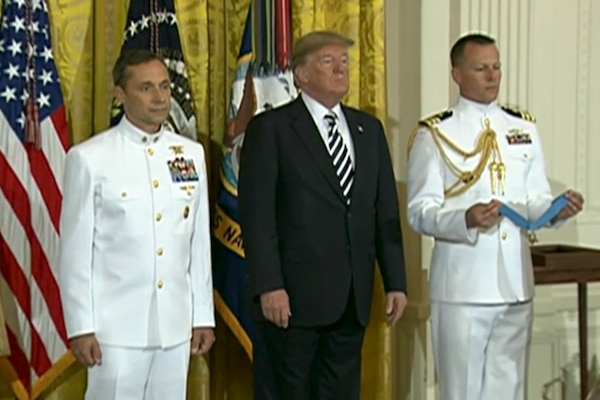 President Donald J. Trump presents the Medal of Honor to retired Navy Master Chief Petty Officer Britt K. Slabinski for his actions during the Battle of Roberts Ridge in Afghanistan at a ceremony in the White House, May 24, 2018. Screenshot via Defense.gov