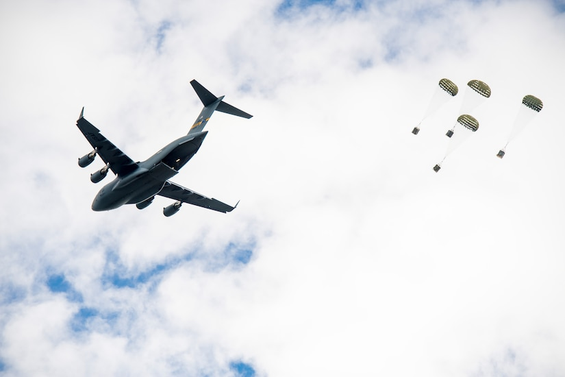 Fifteen C-17 Globemaster III's from the 437th and 315th Airlift Wing, Joint Base Charleston, South Carolina drop heavy platforms and container delivery systems over North Auxiliary Air Field, South Carolina, during an integrated large formation readiness exercise, May 22, 2018.