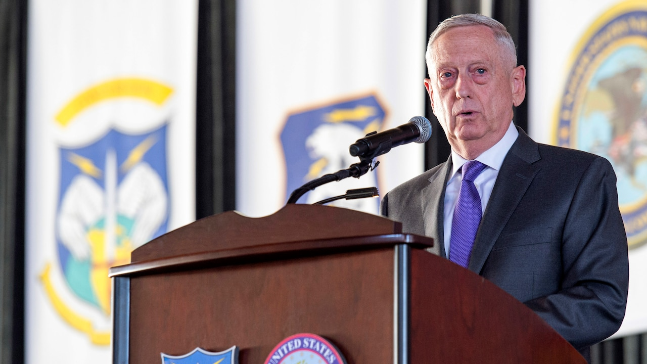 Defense Secretary James N. Mattis provides remarks from behind a podium.