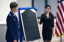 Colonel (Dr.) Karyn E. McKinney, commander of the 59th Training Group, and Jennifer Acton, widow of Staff Sgt. Eric Acton, unveils the new memorial for an Air Force dorm at Joint Base San Antonio - Fort Sam Houston, Texas, May 24, 2018. SSgt. Acton is the only enlisted Air Force medic to succumb to combat related injuries during OIF/OEF.