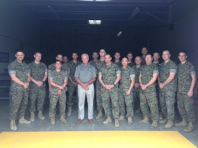 9th Communication Battalion Officers meet with Sergeant Ron Rawlings. Sergeant Rawlings fought with 2nd Battalion, 5th Marines as a Radio Operator at the battle of Hue City during the Vietnam War.