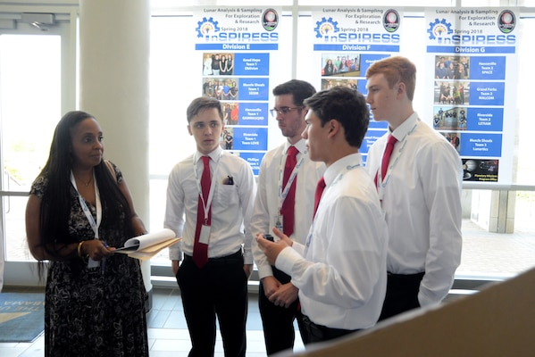 Students from Sparkman High School explain their scientific payload project May 11, 2018, to Lori Cordell-Meikle, chief of Internal Review for Huntsville Center, as part of the Innovative System Project for the Increased Recruitment of Emerging STEM Students at the University of Alabama in Huntsville.