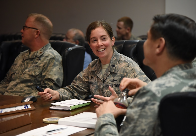 "U.S. Air Force Lt. Col. Jennifer Carns, 85th Engineering Installation Squadron commander, briefs Lt. Gen. Bradford J. ""BJ"" Shwedo, Office of the Secretary of the Air Force, Chief Information Dominance and Chief Information Officer, Pentagon, Washington, D.C., on the 85th EIS mission in Maltby Hall at Keesler Air Force Base, Mississippi, May 22, 2018. In order to become more familiar with Keesler's training mission, Shwedo also toured squadrons within the 81st Training Group. (U.S. Air Force photo by Kemberly Groue)"
