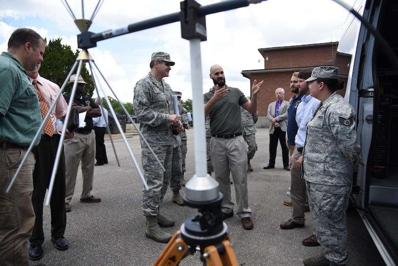 "Andrew Hall, 85th Engineering Installation Squadron electronics engineer, provides U.S. Air Force Lt. Gen. Bradford J. ""BJ"" Shwedo, Office of the Secretary of the Air Force, Chief Information Dominance and Chief Information Officer, at the Pentagon, Washington, D.C., with a radio frequency spectrum survey demonstration during a tour at Maltby Hall at Keesler Air Force Base, Mississippi, May 22, 2018. In order to become more familiar with Keesler's training mission, Shwedo also toured squadrons within the 81st Training Group. (U.S. Air Force photo by Kemberly Groue)"