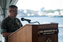 U.S. Marine Corps Col. Christopher Patton, commanding officer, Marine Aircraft Group 24, speaks during the Marine Unmanned Aerial Vehicle Squadron 3 winging ceremony aboard the USS Missouri, Ford Island, Hawaii, May 21, 2018. The Marine Unmanned Aircraft System (UAS) Operator enlisted and officer breast insignia were authorized for wear on May 5, 2018 to recognize their efforts and contributions in the developing field of unmanned aerial vehicle piloting. (U.S. Marine Corps Photo by Sgt. Alex Kouns)