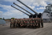 U.S. Marines with Unmanned Aerial Vehicle Squadron 3 pose for a group photo after their winging ceremony aboard the USS Missouri, Ford Island, Hawaii, May 21, 2018. The Marine Unmanned Aircraft System (UAS) Operator enlisted and officer breast insignia were authorized for wear on May 5, 2018 to recognize their efforts and contributions in the developing field of unmanned aerial vehicle piloting.(U.S. Marine Corps Photo by Sgt. Alex Kouns)