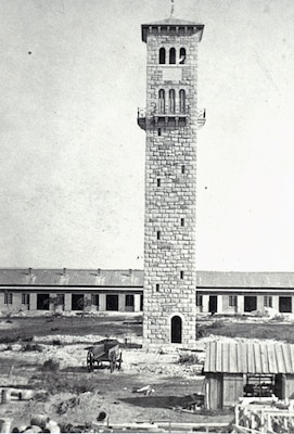 The completed water and watch tower in 1877 before the addition of the clock at the Quadrangle at present-day Joint Base San Antonio-Fort Sam Houston.