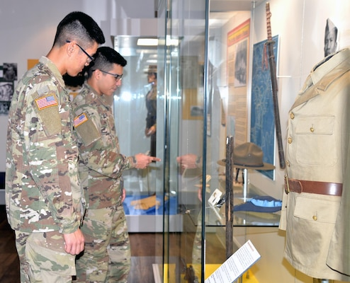 Army Pfc. Class Min Jung (left) and Army Spc. Angel Torres (right) view a historical display at the Fort Sam Houston Museum. Located in the historic Quadrangle, the museum contains six rooms of exhibits, displays and artifacts on the history of Fort Sam Houston and a reference library and archives.