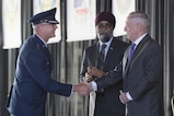 Defense Secretary James N. Mattis shakes hands with Air Force Gen. Terrence J. O'Shaughnessy.