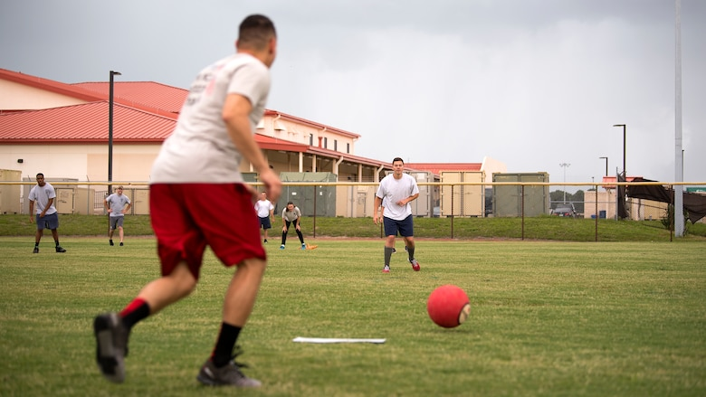 A member of the 6th Security Forces Squadron prepares to kick a ball during a Battle of the Badges kickball game against the fire department at MacDill Air Force Base, Fla., May 22, 2018. This year's recognition of Police Week consisted of a variety of events that included a remembrance ceremony, a 24-hour vigilance run and a kickball game.