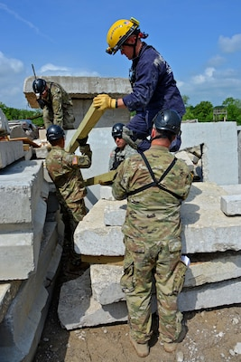 Members of the Utah National Guard Homeland Response Force (HRF) participated in regional disaster training in Missouri, May 14-18, 2018, as part of the New Madrid Seismic Zone (NMSZ) exercise hosted by the Missouri National Guard. The UTNG 116th Engineer Company trained with members of Missouri Task Force One during search and extraction missions, shoring of unstable structures and breaching of structures to reach hypothetical patients.