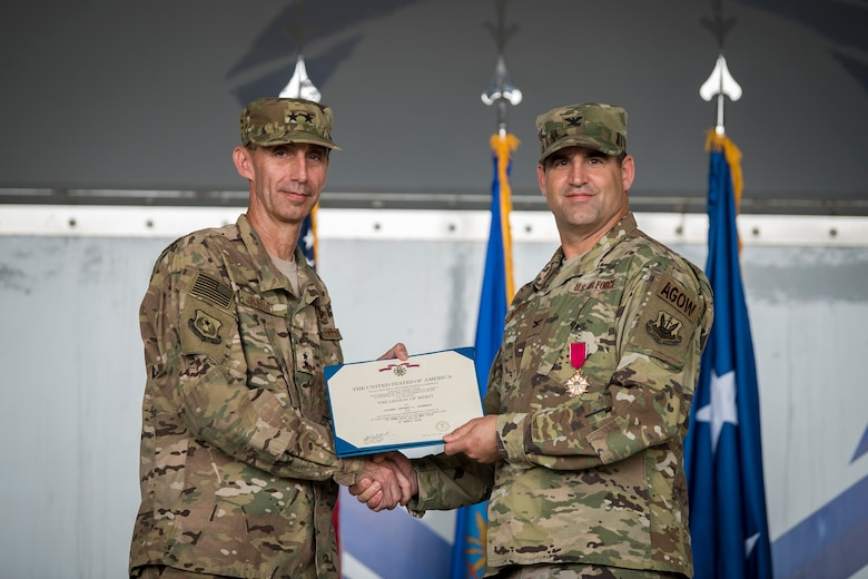 U.S. Air Force Maj. Gen. Scott J. Zobrist, left, 9th Air Force commander, presents Col. Jeffrey Valenzia, 93d Air Ground Operations Wing (AGOW) outgoing commander, with a Legion of Merit during a change of command ceremony, May 23, 2018, at Moody Air Force Base, Ga. The 93d AGOW activated in 2008 and became the first wing to provide highly trained ground combat forces capable of integrating air and space power into the ground scheme of fire and maneuver. They also provide forces capable of employing air power activities in close coordination with land operations, including combat weather support to land forces. (U.S. Air Force photo by Airman 1st Class Eugene Oliver)
