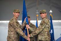U.S. Air Force Col. Jeffrey Valenzia, right, 93rd Air Ground Operations Wing (AGOW) outgoing commander, passes the guidon to Maj. Gen. Scott J.  Zobrist, 9th Air Force commander, during a change of command ceremony, May 23, 2018, at Moody Air Force Base, Ga. The 93rd AGOW is comprised of 2,800 battlefield Airmen at more than 20 locations across the continental U.S. Those locations include three operational groups, 17 squadrons, 10 detachments and 12 operating locations.  (U.S. Air Force photo by Airman 1st Class Eugene Oliver)