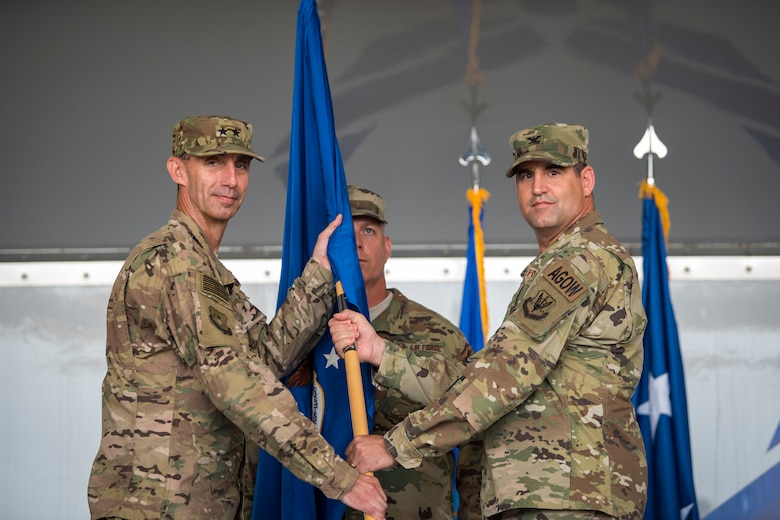 U.S. Air Force Col. Jeffrey Valenzia, right, 93d Air Ground Operations Wing (AGOW) outgoing commander, passes the guidon to Maj. Gen. Scott J.  Zobrist, 9th Air Force commander, during a change of command ceremony, May 23, 2018, at Moody Air Force Base, Ga. The 93d AGOW is comprised of 2,800 battlefield Airmen at more than 20 locations across the continental U.S. Those locations include three operational groups, 17 squadrons, 10 detachments and 12 operating locations.  (U.S. Air Force photo by Airman 1st Class Eugene Oliver)