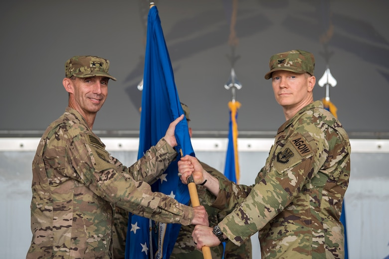 U.S. Air Force Maj. General Scott J. Zobrist, left, 9th Air Force Commander, passes the guidon to Col. Paul Birch, 93d Air Ground Operations Wing (AGOW) incoming commander, during a change of command ceremony, May 23, 2018, at Moody Air Force Base, Ga. The passing of the guidon represents the official changing of leadership and symbolizes who members in a unit owe their allegiance. This event marks the beginning of a new regime as Birch becomes the 7th commander of the 93rd AGOW. (U.S. Air Force photo by Airman 1st Class Eugene Oliver)
