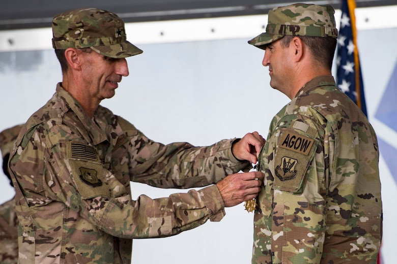U.S. Air Force Maj. Gen. Scott J.  Zobrist, left, 9th Air Force commander, pins the Legion of Merit on Col. Jeffery Valenzia, 93d Air Ground Operations Wing outgoing commander, during a change of command ceremony, May 23, 2018, at Moody Air Force Base, Ga. After relinquishing command, Valenzia will assume duty as the executive assistant to the North American Aerospace Defense Command U.S. Northern Command commander at Peterson Air Force Base, Colo. (U.S. Air Force photo by Senior Airman Janiqua P. Robinson)