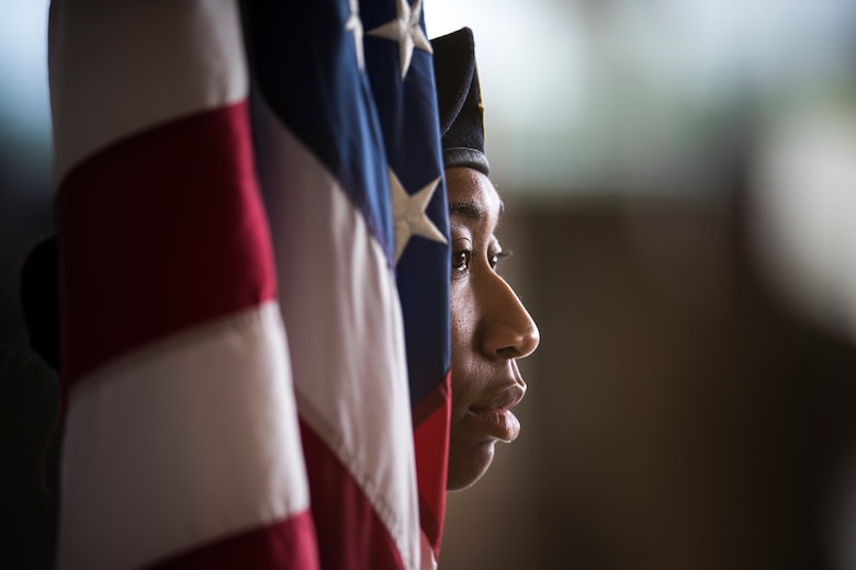 An Airman from the 822nd Base Defense Squadron holds the flag at a change of command ceremony, May 23, 2018, at Moody Air Force Base, Ga. The event marks the beginning of a new regime as Col. Paul Birch becomes the 7th commander of the 93d Air Ground Operations Wing and its battlefield Airmen. (U.S. Air Force photo by Staff Sgt. Ryan Callaghan)