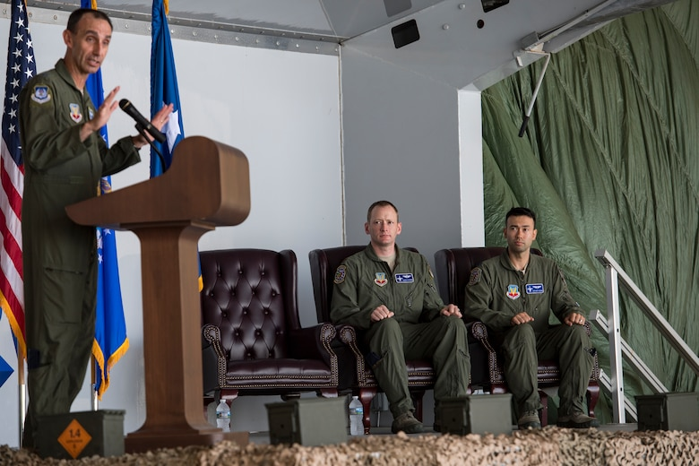 "U.S. Air Force Maj. Gen. Scott J. Zobrist, left, 9th Air Force commander, speaks during an award ceremony, May 23, 2018, at Moody Air Force Base, Ga. The ceremony was held to honor Maj. Matthew ""Chowder"" Cichowski, center, and Capt. William ""Archer"" Dana, 74th Fighter Squadron A-10 Thunderbolt II pilots, who each received a Distinguished Flying Cross.  The Distinguished Flying Cross is awarded to any officer or enlisted member of the U.S. Armed Forces who distinguishes themselves in support of operations by heroism or extraordinary achievement while participating in aerial flight. (U.S. Air Force photo by Senior Airman Janiqua P. Robinson)"